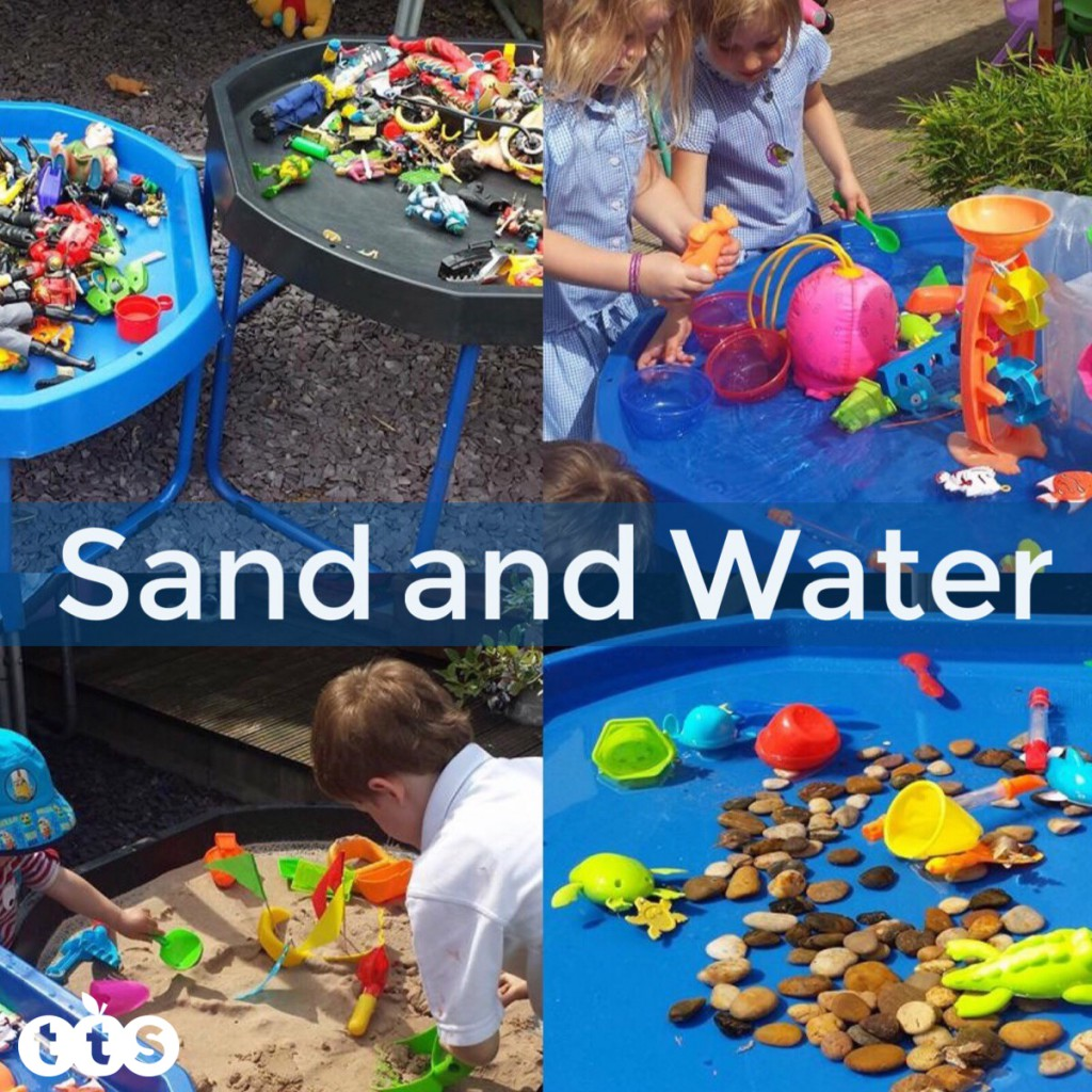 sand and water play outdoors in a tuff spot tray