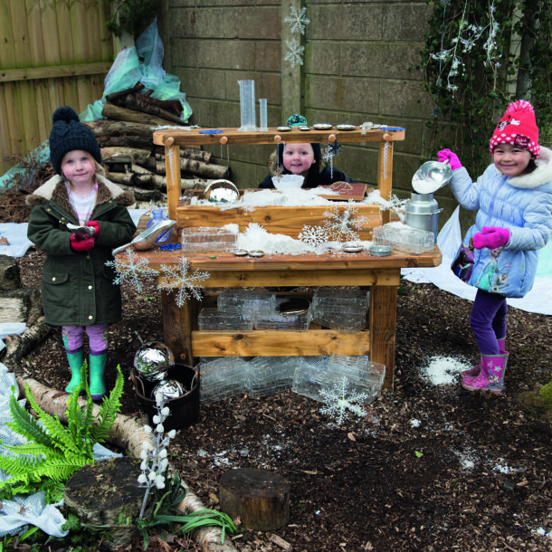 Messy play with snow and ice outdoors