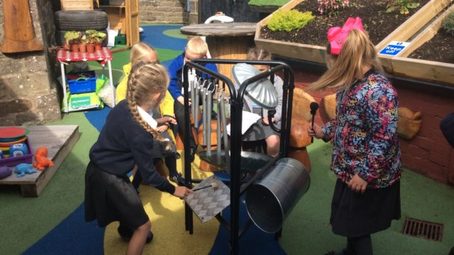 Children practise their drumming skills on the Funky Junk Yard kit.