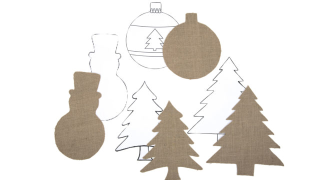 Christmas shapes made out of paper backed hessian.
