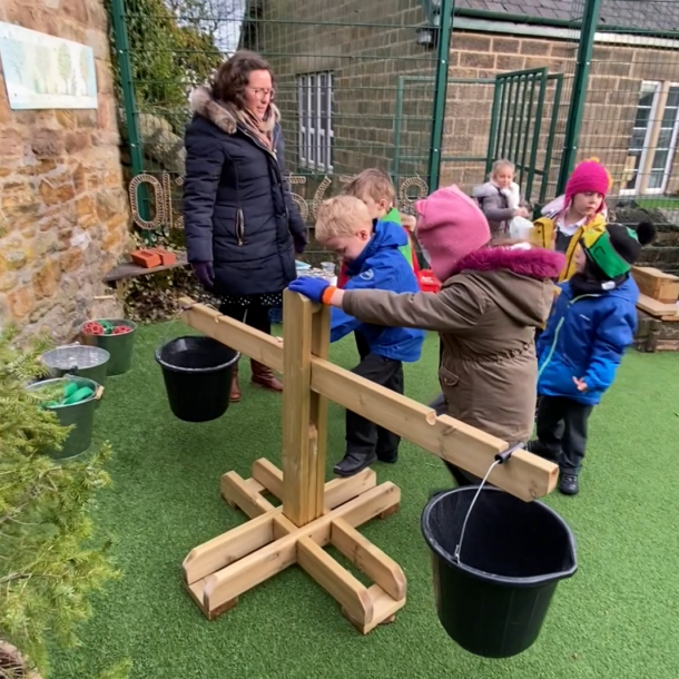 Children use the Giant Wooden Scales.